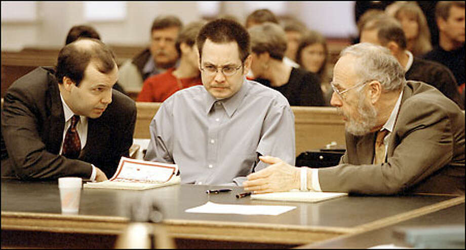 Kevin Cruz, center, listens as his attorneys, Eric Lindell, left, and Tony Savage, right, confer during yesterday's opening arguments in Cruz's trial. Cruz maintains steadfastly he is innocent. Photo: Gilbert W. Arias/Seattle Post-Intelligencer