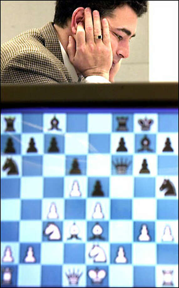 Yasser Seirawan plays in the U.S. Chess Championships. In front is a screen that displays the progress of the game. Photo: Paul Kitagaki Jr./Seattle Post-Intelligencer