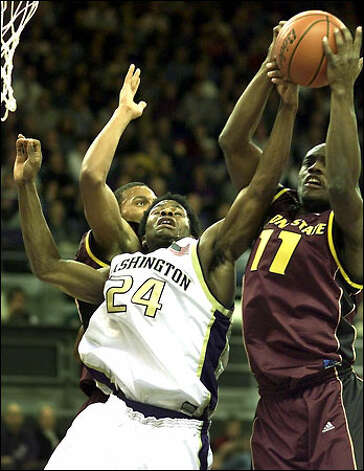Former Washington standout Doug Wrenn battles Arizona State's Awvee Storey for a rebound in this 2002 picture. Photo: Dan DeLong/Seattle Post-Intelligencer
