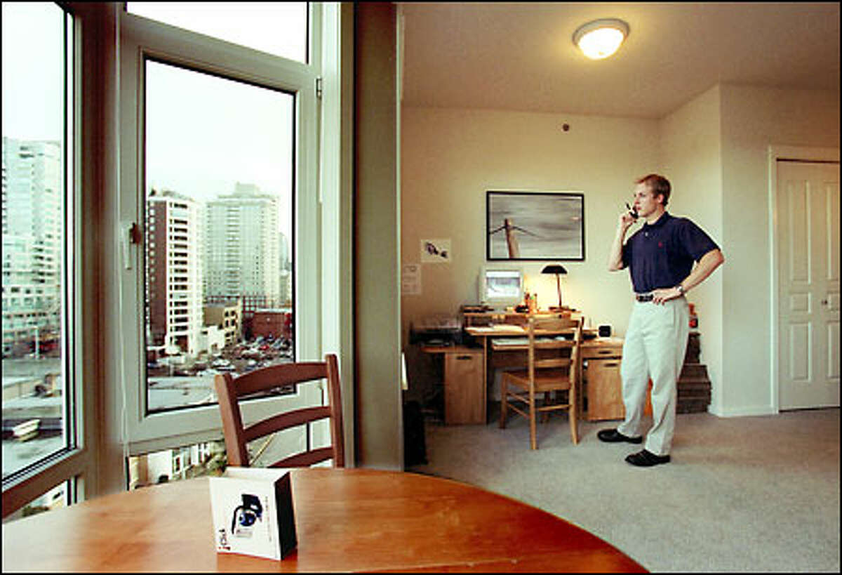 Lon McGowan chats with a bank about his company, McGowan Technologies. He operates out of a condo studio on First Avenue, and doesn't have much living space.