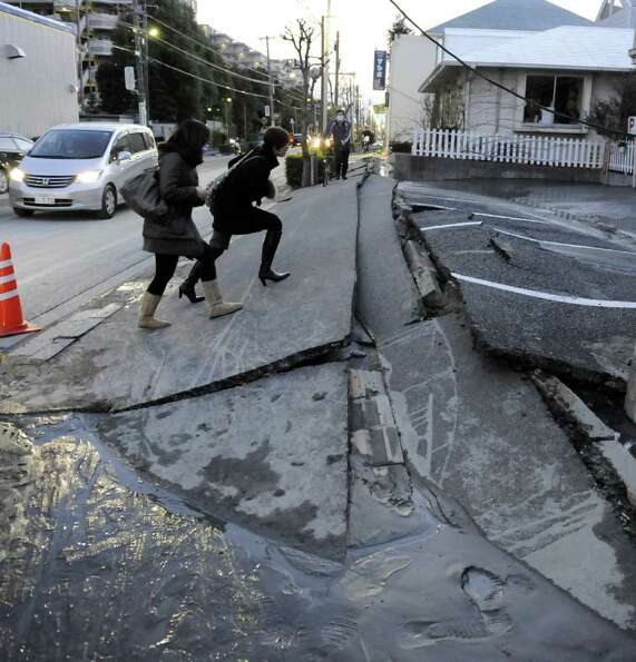 A pedestrian road has collapsed in the massive 8.9-magnitude earthquake in Urayasu city, Chiba prefe