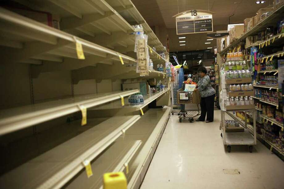 Shelves at a supermarket in Honolulu, Hawaii, are empty after customers bought supplies on March 11, 2011 as they prepared for a possible tsunami.  The first waves to hit Hawaii from a tsunami triggered by a massive earthquake off Japan washed up onshore at Waikiki on Friday, with no initial reports of any damage. The Pacific Tsunami Warning Center reported wave changes at Waianae Harbor at around 3:24 a.m. (1324 GMT), shortly before the relatively small waves were seen at Waikiki.      AFP PHOTO/Kent Nishimura (Photo credit should read Kent Nishimura/AFP/Getty Images) Photo: KENT NISHIMURA