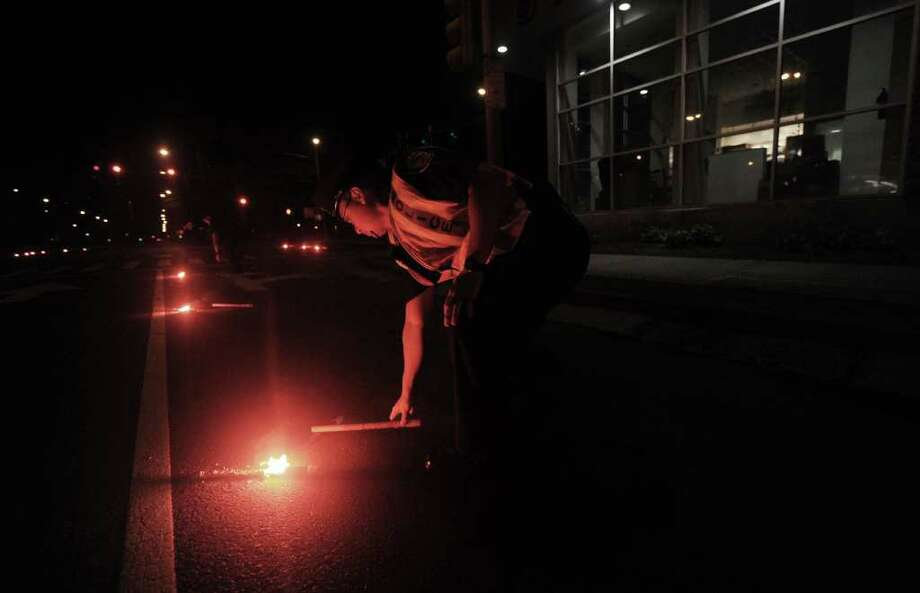 HONOLULU, HAWAII - MARCH 11:  Police place roadside flares along the highway on March 11, 2011 in Honolulu, Hawaii. An earthquake measuring 8.9 on the Richter scale has hit the northeast coast of Japan causing tsunami alerts throughout the Pacific Ocean. Thousands along the coast are evacuating their homes in Hawaii as the state prepares for tsunami waves.  (Photo by Lucy Pemoni/Getty Images) Photo: Lucy Pemoni