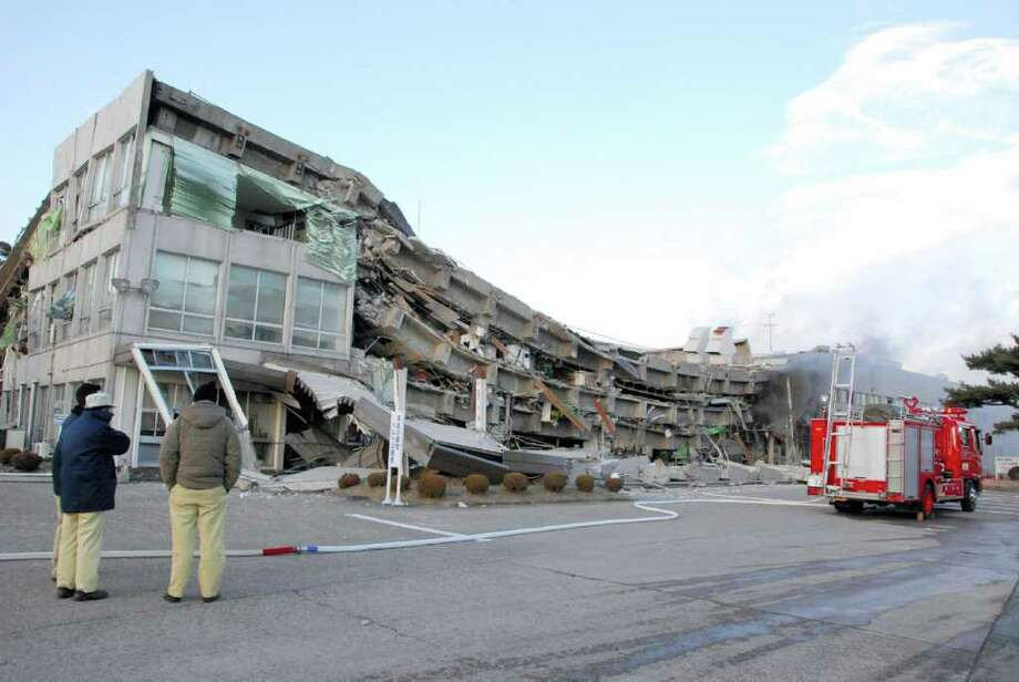 A factory building has collapsed in Sukagawa city, Fukushima prefecture, in northern Japan on March 11, 2011.  A massive 8.9-magnitude earthquake shook Japan, unleashing a powerful tsunami that sent ships crashing into the shore and carried cars through the streets of coastal towns.     AFP PHOTO / FUKUSHIMA MINPO via JIJI PRESS (Photo credit should read FUKUSHIMA MINPO/AFP/Getty Images) Photo: FUKUSHIMA MINPO