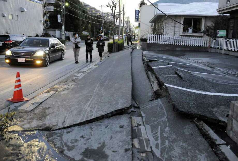 A pedestrian road has collapsed in the massive 8.9-magnitude earthquake in Urayasu city, Chiba prefecture on March 11, 2011. The earthquake shook Japan, unleashing powerful tsunamis that sent ships crashing into the shore and carried cars through the streets of coastal towns. AFP PHOTO / TOSHIFUMI KITAMURA (Photo credit should read TOSHIFUMI KITAMURA/AFP/Getty Images) Photo: TOSHIFUMI KITAMURA