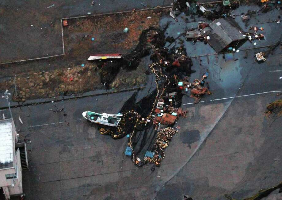 An aerial shot shows a ship sitting on the ground in the port of Hitachinaka city in Ibaraki prefecture on March 11, 2011 after a tsunami tidal wave hit following a a large earthquake. A massive 8.8-magnitude earthquake shook Japan, unleashing a powerful tsunami that sent ships crashing into the shore and carried cars through the streets of coastal towns. AFP PHOTO / JIJI PRESS (Photo credit should read STR/AFP/Getty Images) Photo: STR