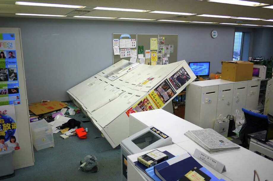 A picture shows an office in disarray after tremors from a massive off-shore earthquake shook the building and knocked over a row of cabinets in Tokyo on March 11, 2011. One of the strongest earthquakes ever recorded hit Japan on March 11, unleashing a 10-metre high tsunami that tossed ships inland and sparked fears that destructive waves could hit across the Pacific Ocean.  MANDATORY CREDIT  AFP PHOTO / HIROKI 'DUKE' KOBAYASHI (Photo credit should read HIROKI 'DUKE' KOBAYASHI/AFP/Getty Images) Photo: HIROKI 'DUKE' KOBAYASHI