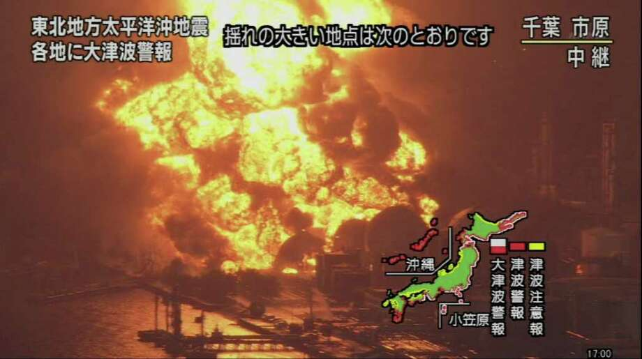 "RESTRICTED TO EDITORIAL USE - MANDATORY CREDIT "" AFP PHOTO / HO / NHK"" - NO MARKETING NO ADVERTISING CAMPAIGNS - DISTRIBUTED AS A SERVICE TO CLIENTS A screen grab taken from news footage by Japanese public broadcaster NHK on March 11, 2011 shows the refinery plant on fire in Ishihara in Chiba prefecture.  A massive 8.9-magnitude earthquake shook Japan, unleashing a powerful tsunami that sent ships crashing into the shore and carried cars through the streets of coastal towns.    JAPAN OUT AFP PHOTO / HO / NHK (Photo credit should read STR/AFP/Getty Images) Photo: STR"