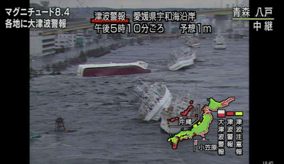 "RESTRICTED TO EDITORIAL USE - MANDATORY CREDIT "" AFP PHOTO / HO / NHK"" - NO MARKETING NO ADVERTISING CAMPAIGNS - DISTRIBUTED AS A SERVICE TO CLIENTS  -  NO ARCHIVES A screen grab taken from news footage by Japanese public broadcaster NHK on March 11, 2011 shows capsized ships at a port of Hachinohe City, Aomori Prefecture.   A massive 8.9-magnitude earthquake shook Japan, unleashing a powerful tsunami that sent ships crashing into the shore and carried cars through the streets of coastal towns.    JAPAN OUT AFP PHOTO / HO / NHK (Photo credit should read -/AFP/Getty Images) Photo: -"