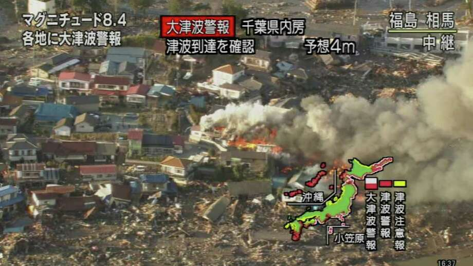 "RESTRICTED TO EDITORIAL USE - MANDATORY CREDIT "" AFP PHOTO / HO / NHK"" - NO MARKETING NO ADVERTISING CAMPAIGNS - DISTRIBUTED AS A SERVICE TO CLIENTS A screen grab taken from news footage by Japanese public broadcaster NHK on March 11, 2011 shows a fire at the tsunami-hit area of Fukushima prefecture, about 200km north of Tokyo.   A massive 8.9-magnitude earthquake shook Japan, unleashing a powerful tsunami that sent ships crashing into the shore and carried cars through the streets of coastal towns.    JAPAN OUT AFP PHOTO / HO / NHK (Photo credit should read STR/AFP/Getty Images) Photo: STR"