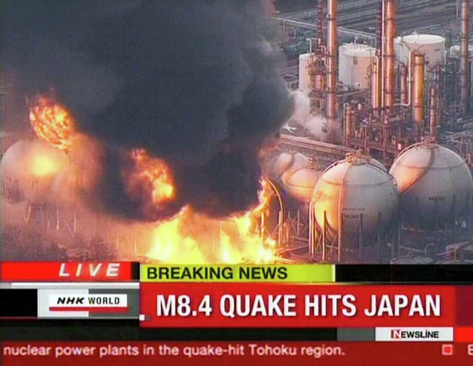 "RESTRICTED TO EDITORIAL USE - MANDATORY CREDIT "" AFP PHOTO / HO / NHK"" - NO MARKETING NO ADVERTISING CAMPAIGNS - DISTRIBUTED AS A SERVICE TO CLIENTS A screen grab taken from news footage by Japanese public broadcaster NHK on March 11, 2011 shows the power plant on fire in Ishihara.   A massive 8.9-magnitude earthquake shook Japan, unleashing a powerful tsunami that sent ships crashing into the shore and carried cars through the streets of coastal towns.    JAPAN OUT AFP PHOTO / HO / NHK (Photo credit should read STR/AFP/Getty Images) Photo: STR"