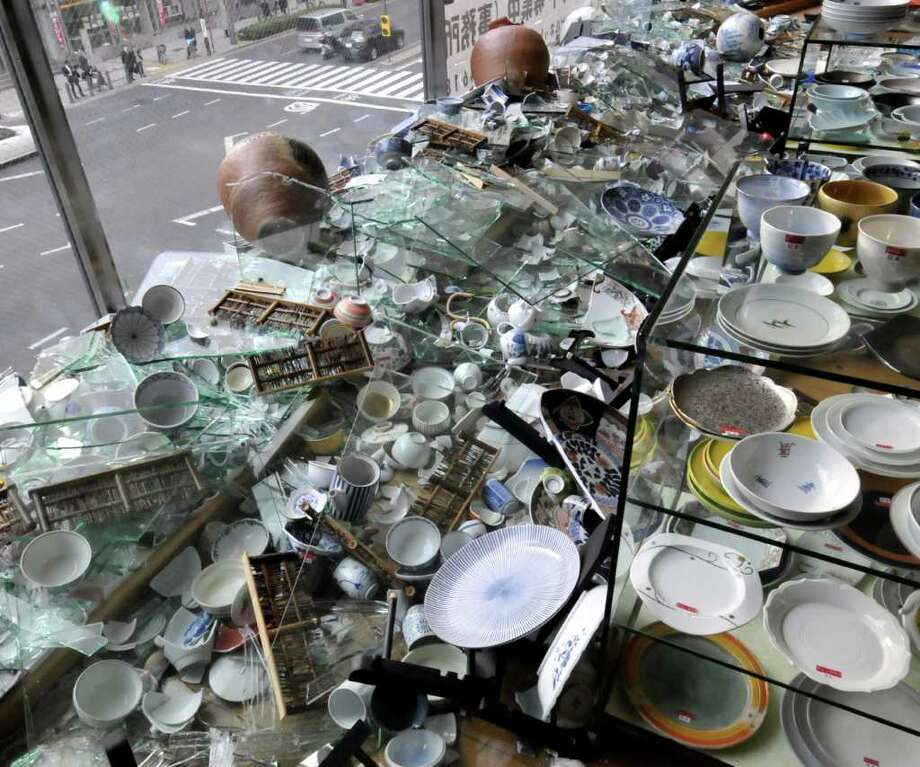 Broken China wares are scattered on the floor at a porcelain shop following a massive 8.9-magnitude earthquake in Tokyo on March 11, 2011. The huge earthquake shook Japan, unleashing a powerful tsunami that sent ships crashing into the shore and carried cars through the streets of coastal towns. AFP PHOTO / Yoshikazu TSUNO (Photo credit should read YOSHIKAZU TSUNO/AFP/Getty Images) Photo: YOSHIKAZU TSUNO