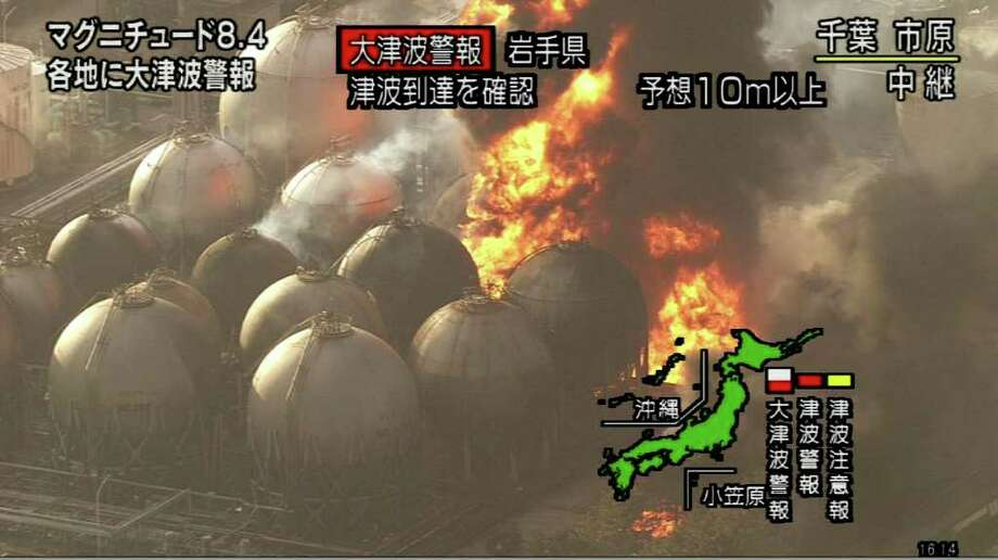 "RESTRICTED TO EDITORIAL USE - MANDATORY CREDIT "" AFP PHOTO / HO / NHK"" - NO MARKETING NO ADVERTISING CAMPAIGNS - DISTRIBUTED AS A SERVICE TO CLIENTS A screen grab taken from news footage by Japanese public broadcaster NHK on March 11, 2011 shows a fire in an oil plant in Chiba prefecture, east of Tokyo.  A massive 8.8-magnitude earthquake shook Japan, unleashing a powerful tsunami that sent ships crashing into the shore and carried cars through the streets of coastal towns.    JAPAN OUT AFP PHOTO / HO / NHK (Photo credit should read STR/AFP/Getty Images) Photo: STR"