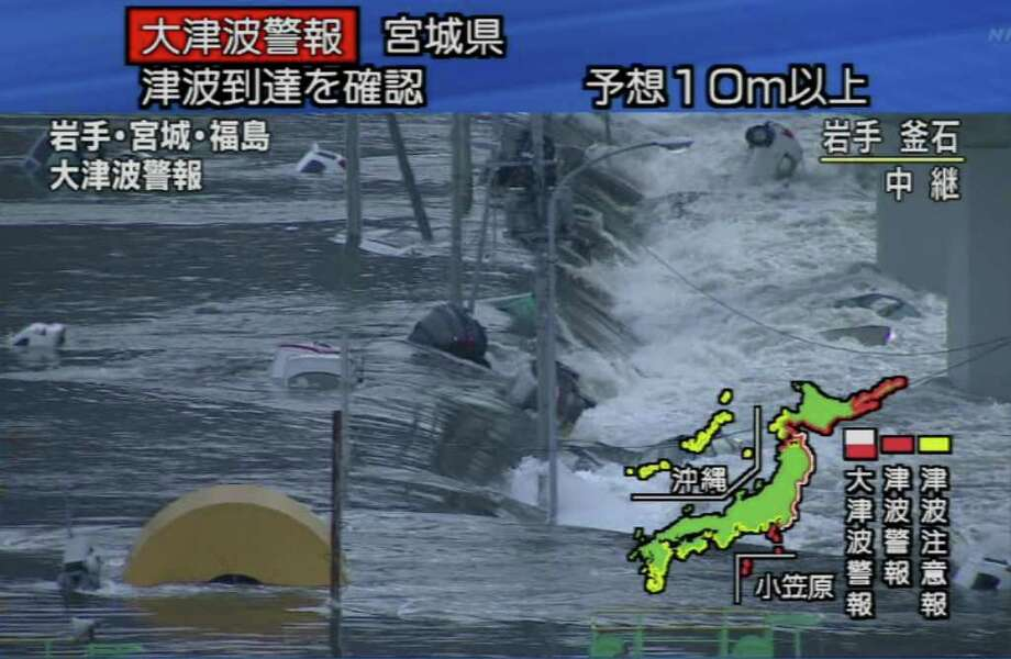 """RESTRICTED TO EDITORIAL USE - MANDATORY CREDIT """" AFP PHOTO / HO / NHK"""" - NO MARKETING NO ADVERTISING CAMPAIGNS - DISTRIBUTED AS A SERVICE TO CLIENTS A screen grab taken from news footage by Japanese Government broadcaster NHK on March 11, 2011 shows cars on a flooded street following an earthquake-triggered tsumani in Miyagi prefecture.  A massive 8.8-magnitude earthquake shook Japan, unleashing a powerful tsunami that sent ships crashing into the shore and carried cars through the streets of coastal towns. JAPAN OUT AFP PHOTO / HO / NHK (Photo credit should read STR/AFP/Getty Images) Photo: STR"""
