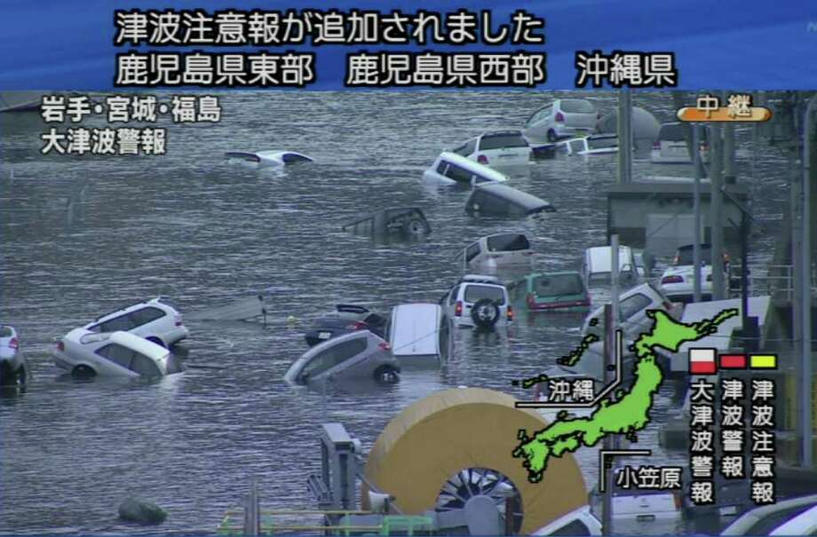 "RESTRICTED TO EDITORIAL USE - MANDATORY CREDIT  "" AFP PHOTO / HO / NHK""  -  NO MARKETING NO ADVERTISING CAMPAIGNS - DISTRIBUTED AS A SERVICE TO CLIENTS A screen grab taken from news footage by Japanese Government broadcaster NHK on March 11, 2011 shows cars on a flooded street following an earthquake-triggered tsumani in Miyagi prefecture. A massive 8.8-magnitude earthquake shook Japan, unleashing a powerful tsunami that sent ships crashing into the shore and carried cars through the streets of coastal towns.        JAPAN OUT        AFP PHOTO / HO / NHK (Photo credit should read STR/AFP/Getty Images) Photo: STR"