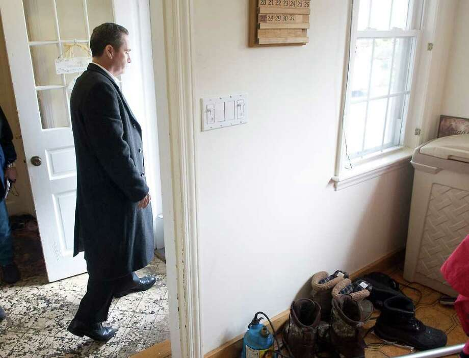 Tony Cologero walks through his home in Wallacks Point that was heavily damaged by a raw sewage spill earlier this week in Stamford, Conn. on Friday March 11, 2011. Photo: Kathleen O'Rourke / Stamford Advocate
