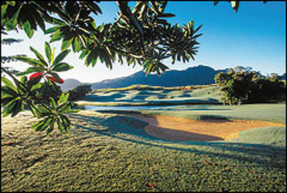 Challenges at the lush 10-hole Grove Farm Golf Course at Puakea include bunkers, ravines, cliffs, lakes and jungle.