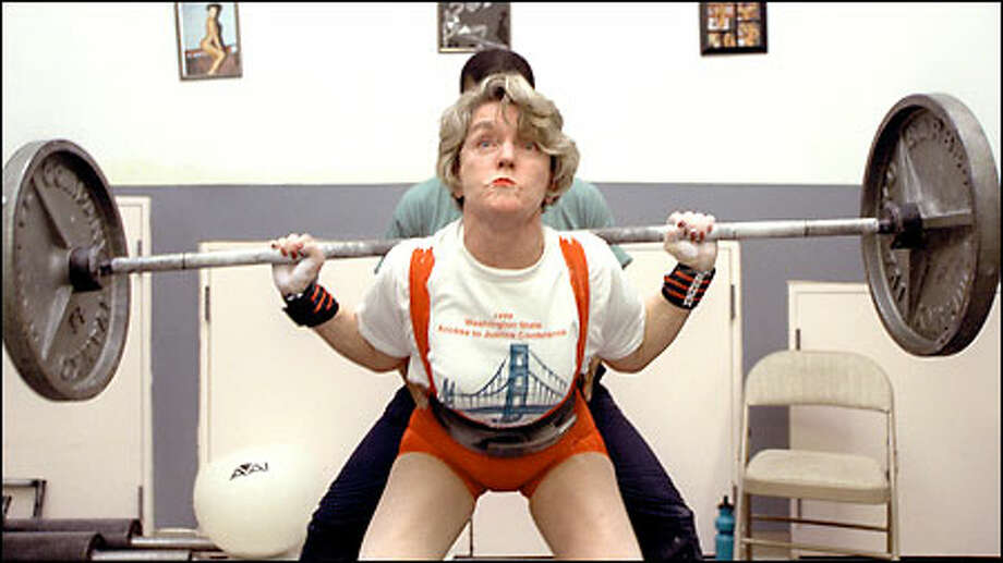 State Supreme Court Justice Faith Ireland, a powerlifter who will compete in the women's nationals next month in Chicago, concentrates during a workout with trainer Paula Houston. Photo: Gilbert W. Arias/Seattle Post-Intelligencer