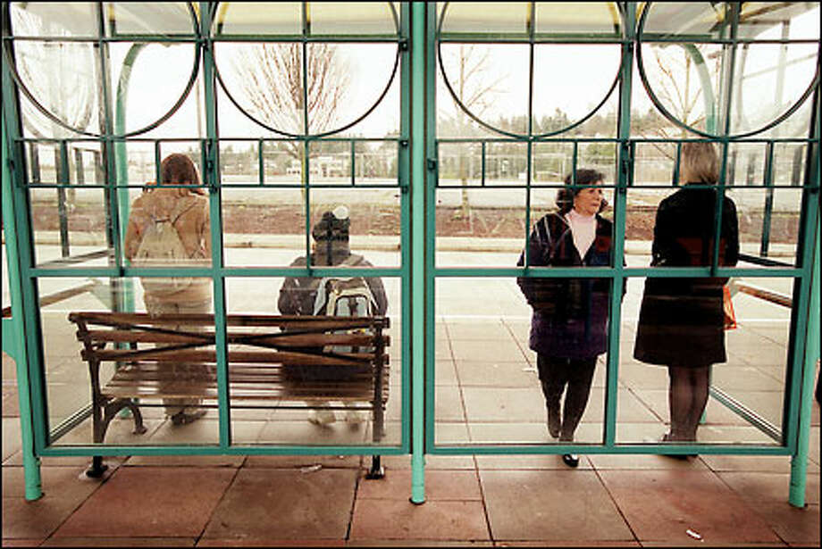 Bus patrons wait at the Northgate Transit Center just south of Northgate Mall. Nearly 4 acres were added to the transit center by a recent purchase. Photo: Joshua Trujillo/Seattle Post-Intelligencer