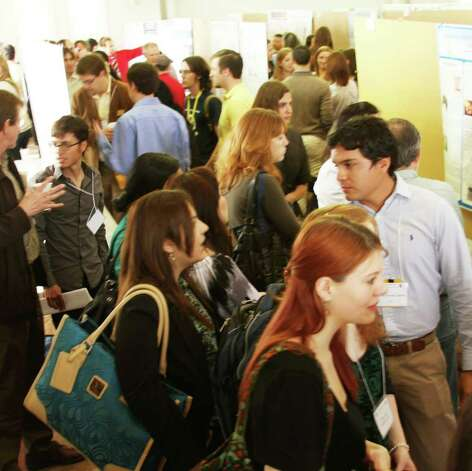 Hundreds of college students from across the  State viewed and explained one another's science posters  during the annual meeting of the Texas Academy of Science. > Photograph by Forrest M. Mims III. Photo: FORREST M MIMS 111