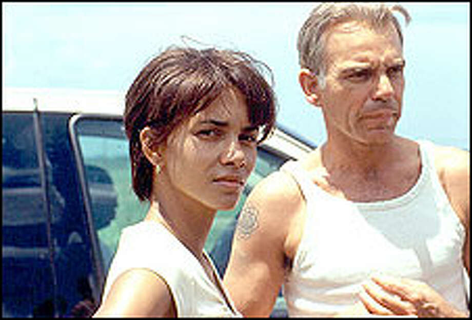 Scarred souls (Halle Berry and Billy Bob Thornton) find comfort and hope in each other's arms. Photo: JEANNE LOUISE BULLIARD