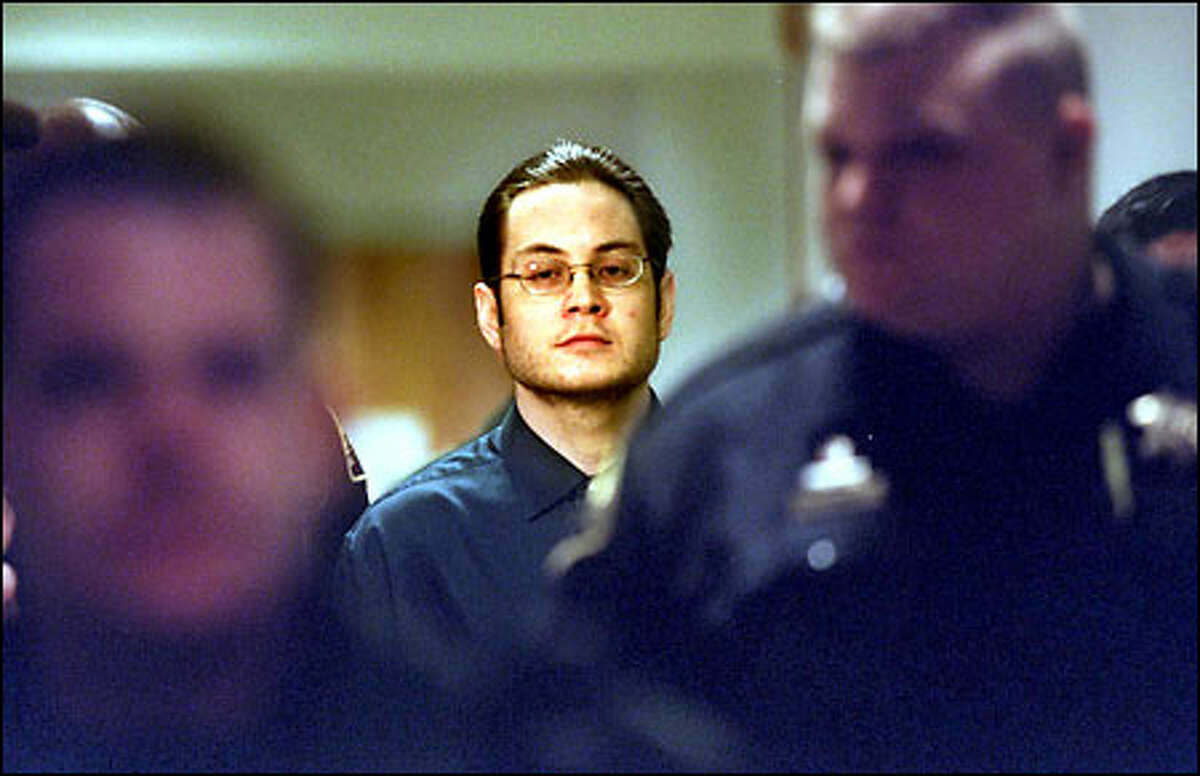Officers escort Kevin Cruz into King County Superior Court in Seattle. A jury convicted Cruz of shooting two people to death and wounding two others at a Lake Union shipyard in November 1999.
