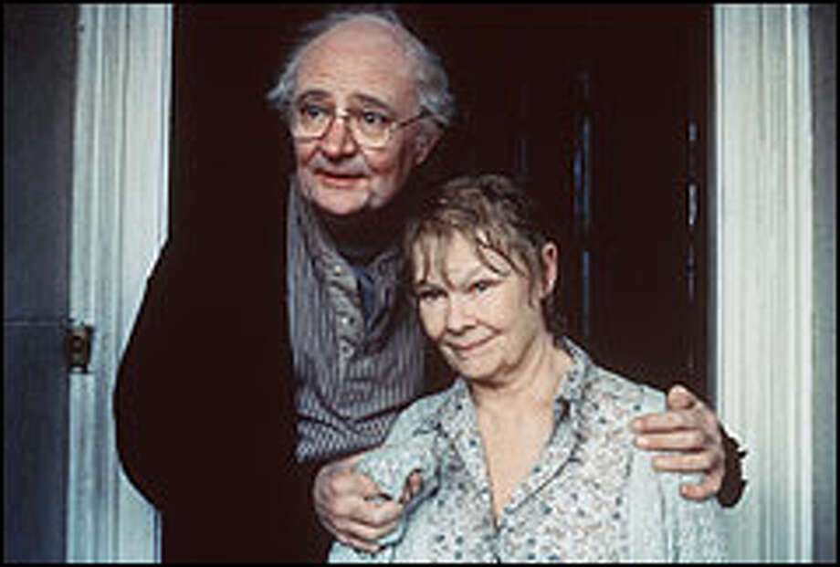 "Judi Dench plays the mentally fading Iris Murdoch and Jim Broadbent plays her husband of 43 years, John Bayley, in ""Iris."" The British author is portrayed in younger life by Kate Winslet. Photo: CLIVE COOTE"