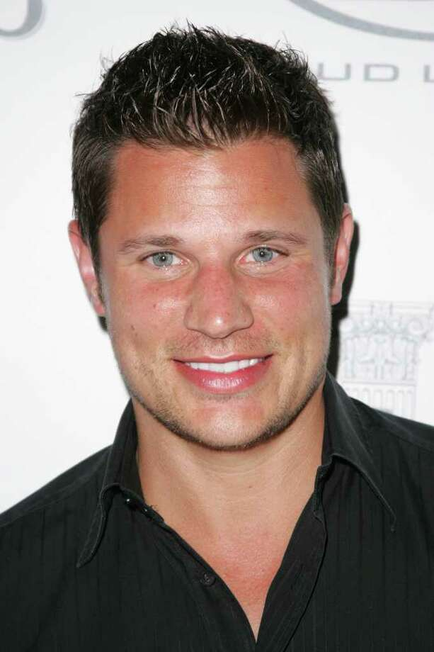 FILE - In this Feb. 4, 2009 file photo, singer Nick Lachey arrives for a party during Superbowl festivities in Miami Beach, Fla. (AP Photo/Carlo Allegri, file) Photo: Carlo Allegri