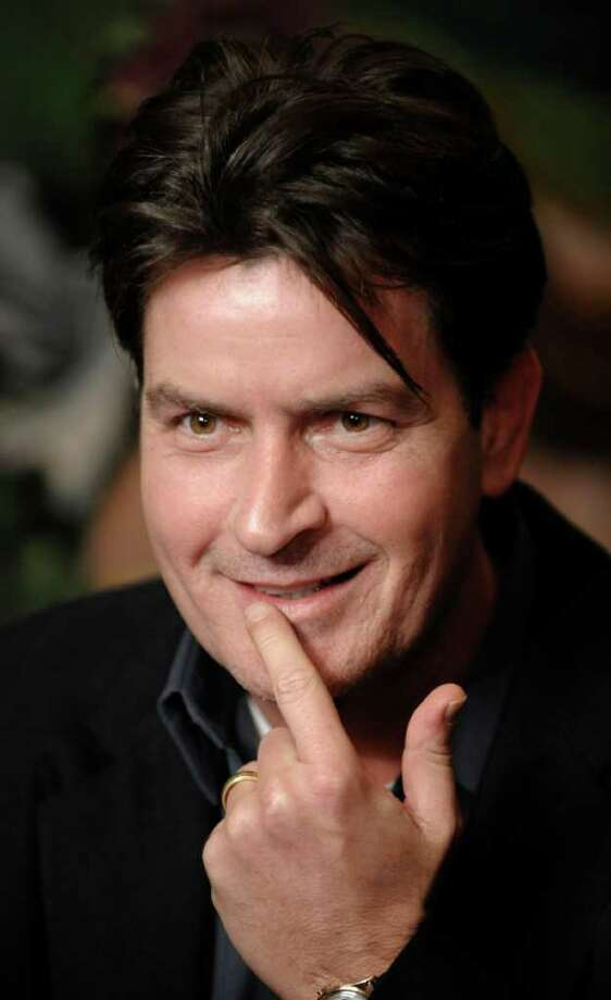 FILE - In this Jan. 28, 2009 file photo, actor Charlie Sheen is interviewed at an event to celebrate Planet Hollywood's purchase of Italian restaurant chain Buca di Beppo, at Universal CityWalk in Los Angeles. (AP Photo/Chris Pizzello, File) Photo: Chris Pizzello