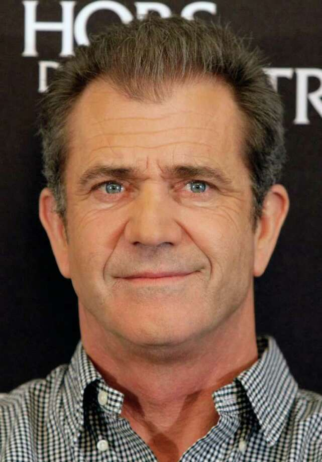 """FILE - In this Feb. 4, 2010 file photo, actor Mel Gibson looks on during a photocall to promote the movie """"Edge of Darkness"""", in  Paris. Gibson is expected to be charged Friday March 11, 2011 with misdemeanor battery and appear in a Los Angeles courtroom to plead guilty and be sentenced. (AP Photo/Francois Mori, file) Photo: FRANCOIS MORI"""