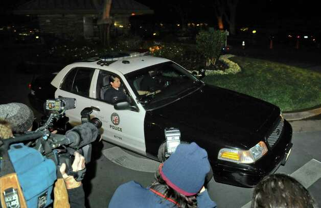 Los Angeles police leave actor Charlie Sheen's Sherman Oaks home in Los Angeles after executing a search warrant weapons, Thursday, March 10, 2011. No weapons were allegedly found. (AP Photo/Gus Ruelas) Photo: Gus Ruelas
