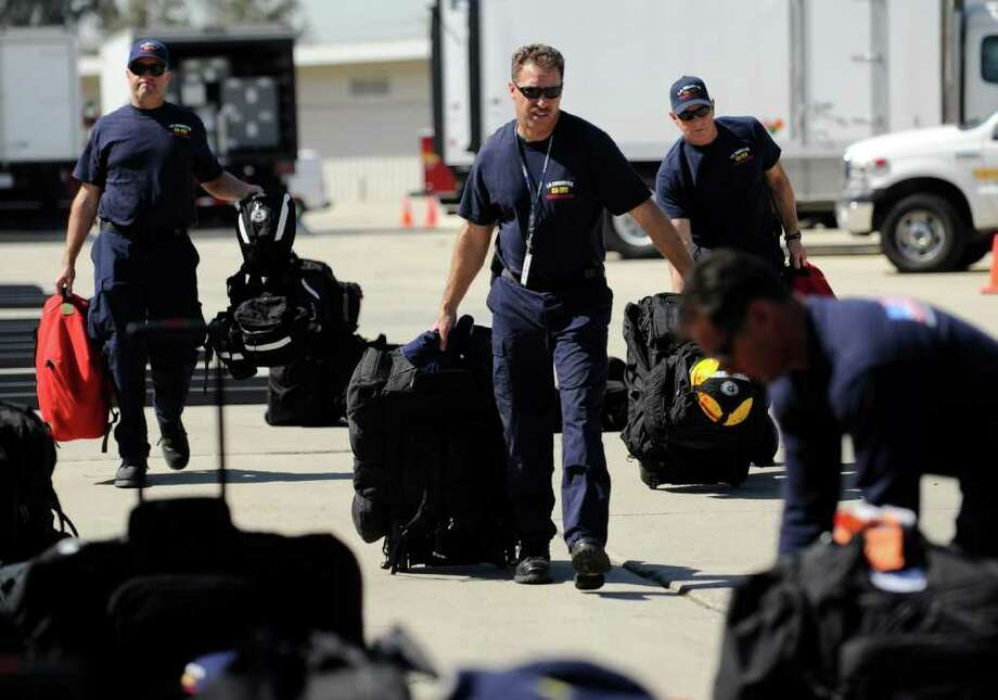 Members of the Los Angeles County urban search and rescue team prepare to deploy to Japan, Friday, March 11, 2011, in Los Angeles. Japan was hit with a magnitude 8.9 earthquake Friday morning. (AP Photo/Gus Ruelas) Photo: Gus Ruelas