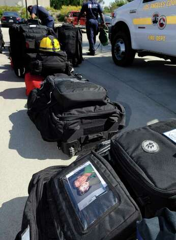 Go bags and equipment are prepared as members of the Los Angeles County urban search and rescue team prepare to deploy to Japan, Friday, March 11, 2011, in Los Angeles. Japan was hit with a magnitude 8.9 earthquake Friday morning. (AP Photo/Gus Ruelas) Photo: Gus Ruelas