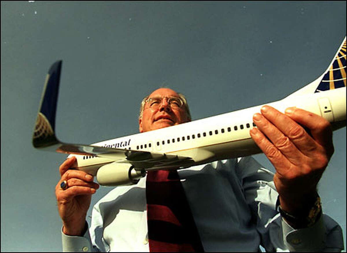 Joe Clark, CEO of Aviation Partners Inc., displays a model of a Continental Boeing 737-700 with blended winglets. Continental is being wooed to install winglets on its jets.