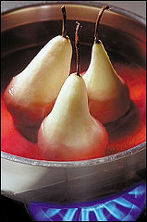 Fruits such as apples, pears, rhubarb or prunes are excellent choices for poaching, making simple desserts that require little more than a dollop of a rich sauce. Here Bosc pears are poached in red wine. Photo: PAUL JOSEPH BROWN/P-I