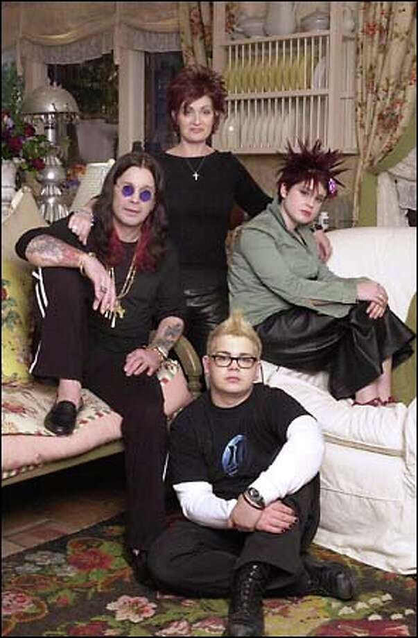 """With a whole lotta (bleeping) going on, MTV chronicles the daily existence of a rock 'n' roll family in """"The Osbournes,"""" featuring Ozzy Osbourne, left, wife Sharon, standing, daughter Kelly and son Jack. In this household, the f-word is just another parenting tool."""