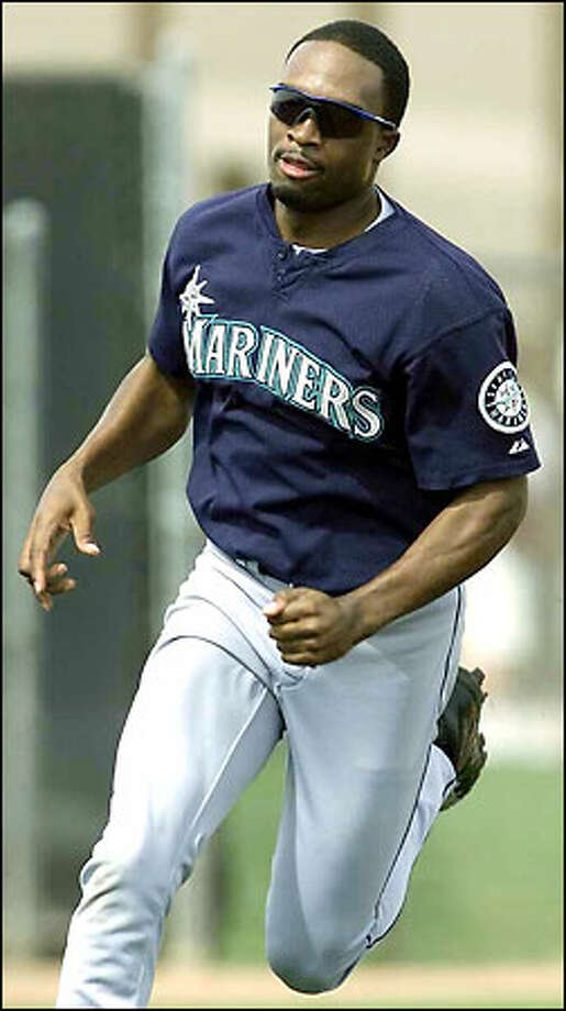 If manager Lou Piniella is correct, Kenny Kelly could be a big-league fixture in 2003. Photo: Dan DeLong/Seattle Post-Intelligencer