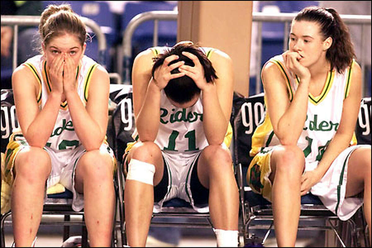 Roosevelt players -- from left, Tracy Leddo, Shannon Costello and Hillary Seidel -- can't bear to watch as the final seconds tick away in the Roughriders' 48-42 first-round loss to Kentlake.