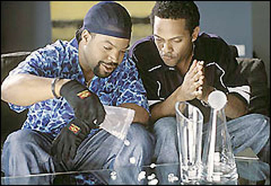 A bounty hunter (Ice Cube, left) and a con man (Mike Epps) team up to find a fortune. Photo: TRACY BENNETT