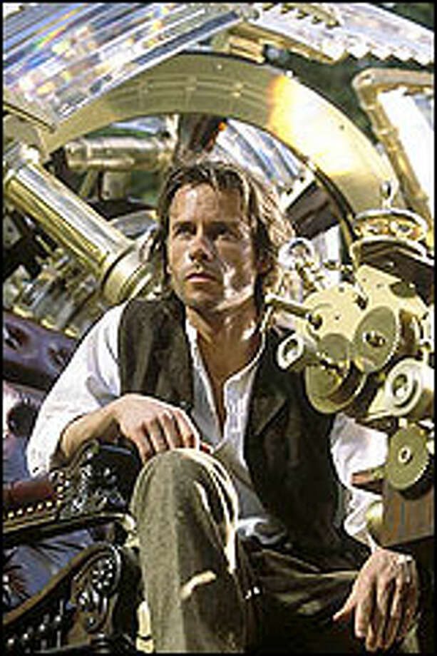 A Columbia University professor (Guy Pearce) tries to regain his tragically lost love with the help of his time machine, traveling 800,000 years into the future from 1890s New York. Photo: DREAMWORKS AND WARNER BROS.
