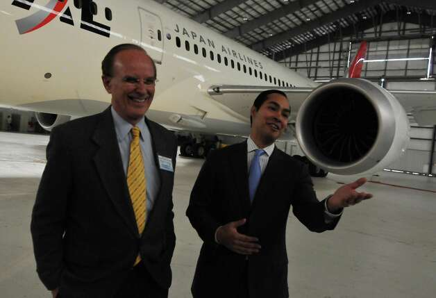 Bexar County Judge Nelson Wolff and Mayor Julian Castro share a laugh following the unveiling of the 787 Dreamliner at the Boeing facility. Photo: ROBIN JERSTAD/SPECIAL TO THE EXPRESS-NEWS