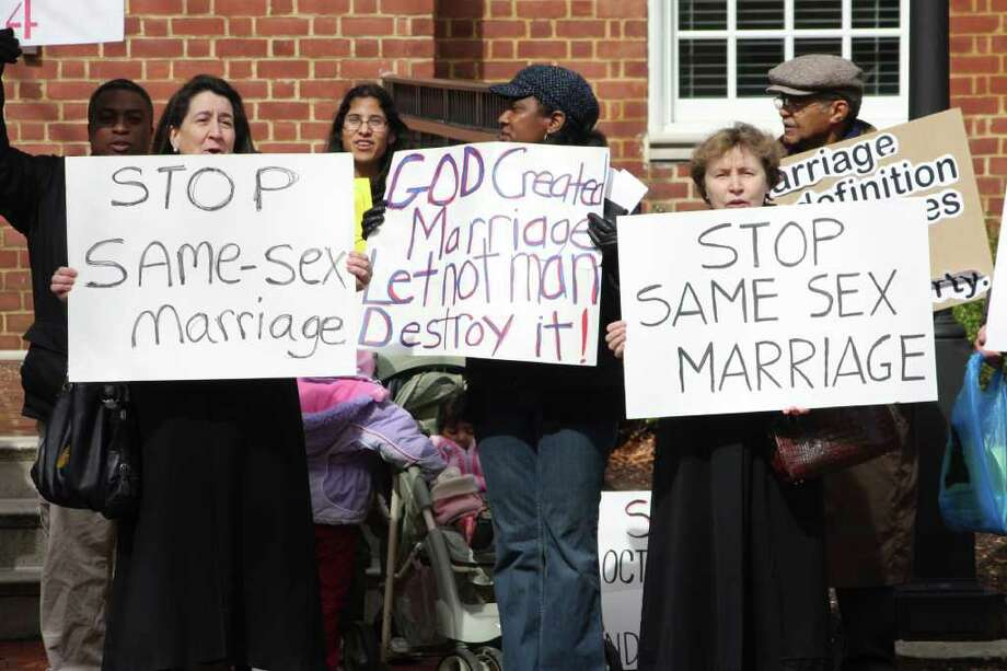 Opponents of gay marriage rally in Annapolis, Md., Friday, March 11, 2011 before the Maryland House of Delegates holds a vote on legislation that would give same-sex couples in Maryland the same marriage rights as heterosexuals. (AP Photo/Brian Witte) Photo: Brian Witte