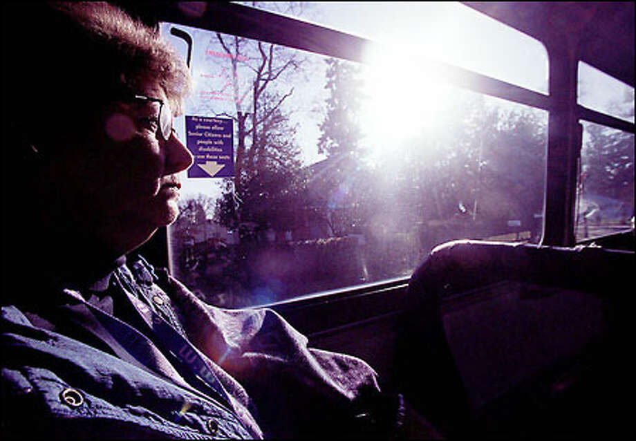 """Charan Bird, who's been able to manage her schizophrenia, rides the bus all over Lakewood and Tacoma, but it's been an adjustment for her. """"Most of the time, I find it calming but sometimes when a man is loud or disruptive, it reminds me of my stepfather who abused me,"""" says Bird. Photo: Renee C. Byer/Seattle Post-Intelligencer"""