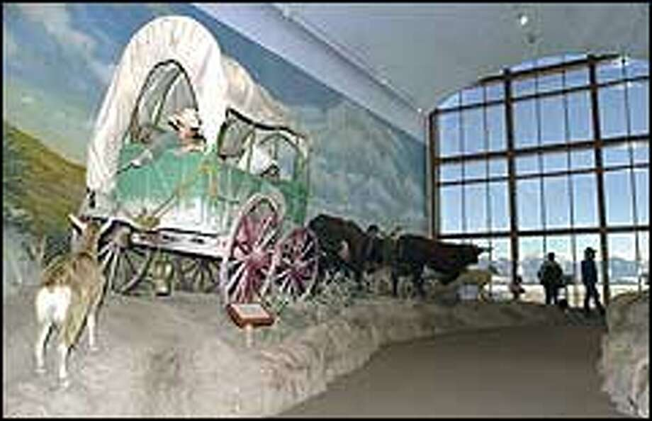 A covered wagon display at the Oregon Trail Interpretive Center in Baker City, Ore. To remind visitors of the perilous Oregon Trail journey made by long-ago travelers, museums, wayside stops and parks have been built along the way.