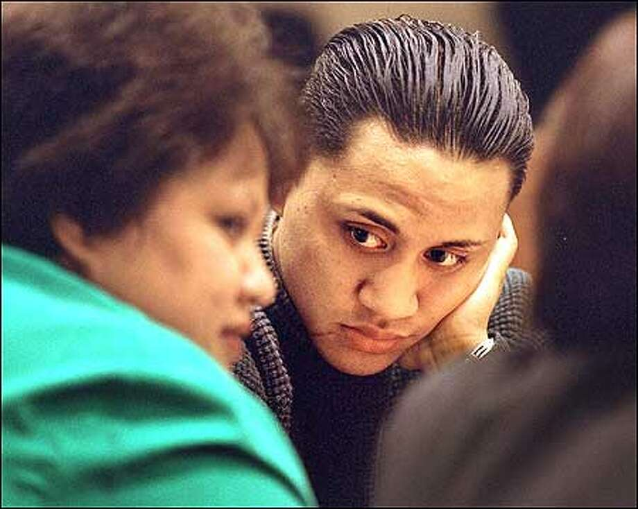 Vili Fualaau, right, looks toward his mother, Soona Vili, during a recess in Kent Thursday. He is suing the Highline School District and the city of Des Moines. Photo: Renee C. Byer/Seattle Post-Intelligencer