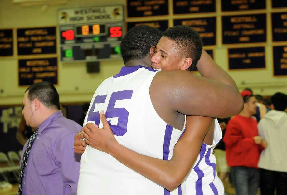 With the final score displayed behind them, Weston's Ervin Thompson and Chris Walter react to the loss as Westhill High School is bested by Glastonbury High School in boys varsity basketball at Westhill High School in Stamford, CT on Friday evening, March 11, 2011. Photo: Shelley Cryan / Shelley Cryan freelance; Shelley Cryan for the Stamford Advocate