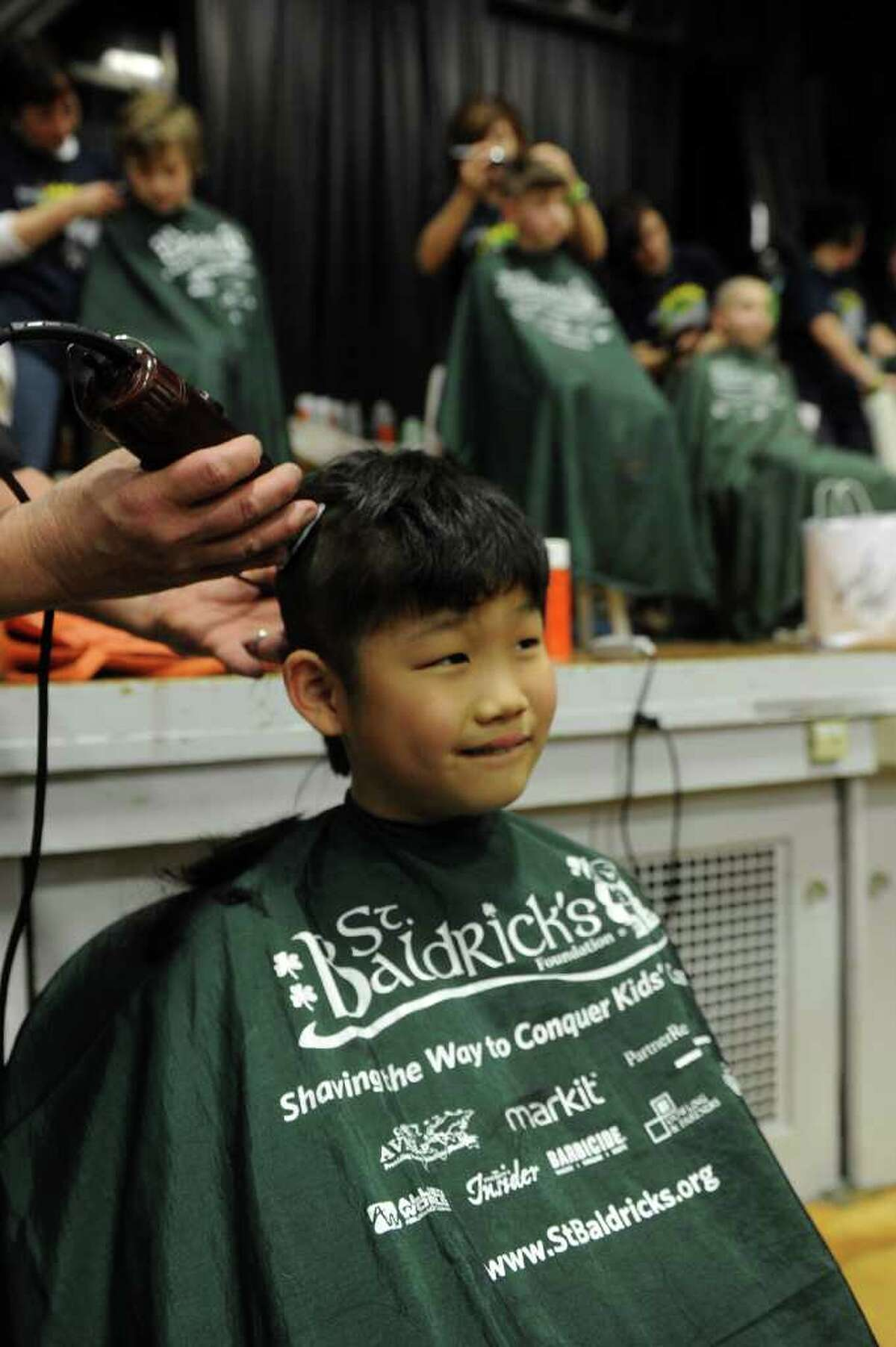 Jae Leighton, 9, gets his hair saved during Friday's St. Baldrick's fundraiser for children with cancer on March 11, 2011.
