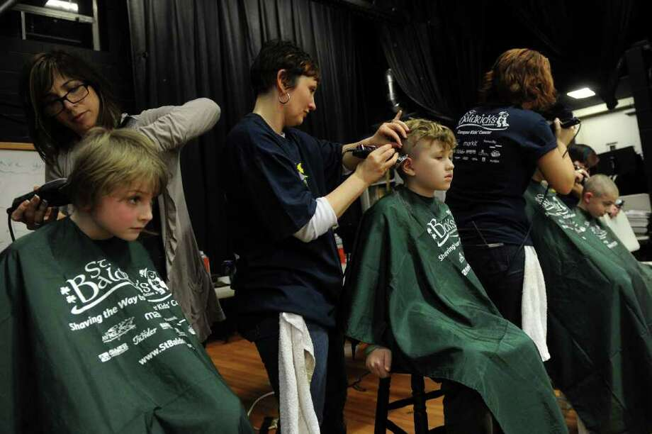 Kids and adults get their hair shaved during Friday's St. Baldrick's fundraiser for children with cancer on March 11, 2011. Photo: Lindsay Niegelberg / Connecticut Post