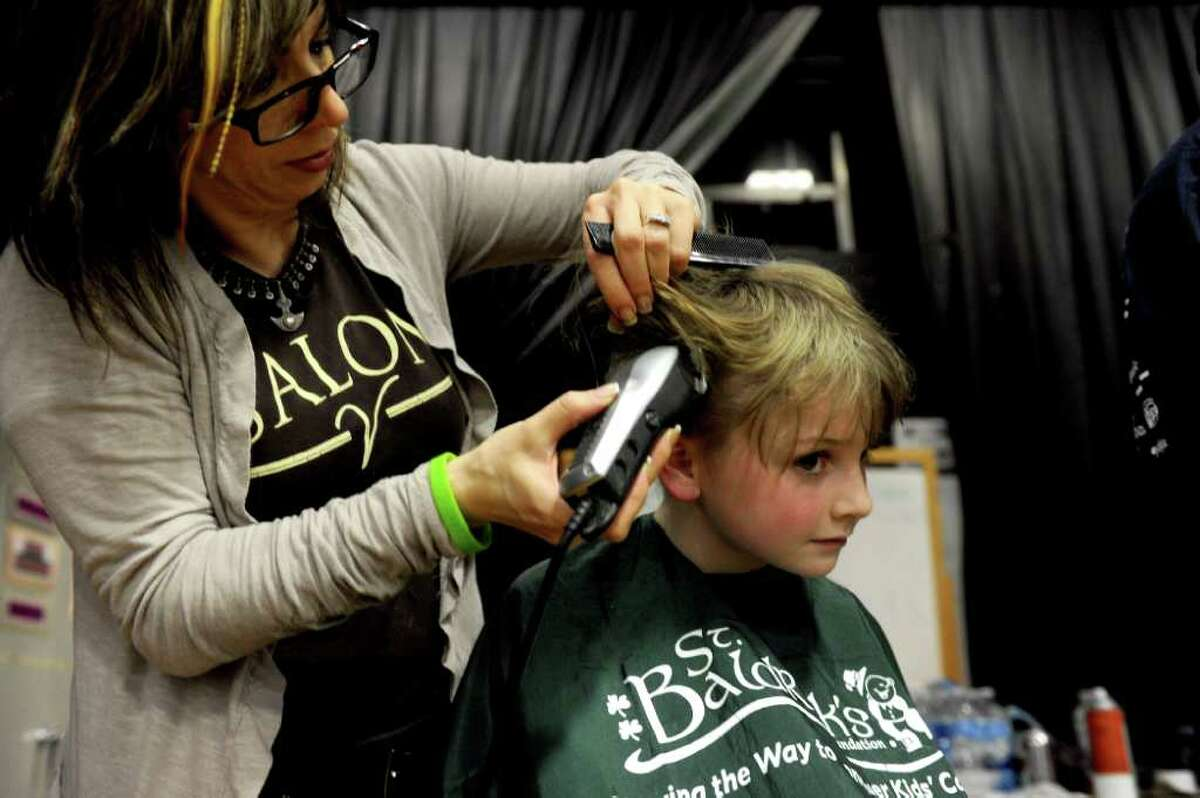 Kids and adults get their hair shaved during Friday's St. Baldrick's fundraiser for children with cancer on March 11, 2011.