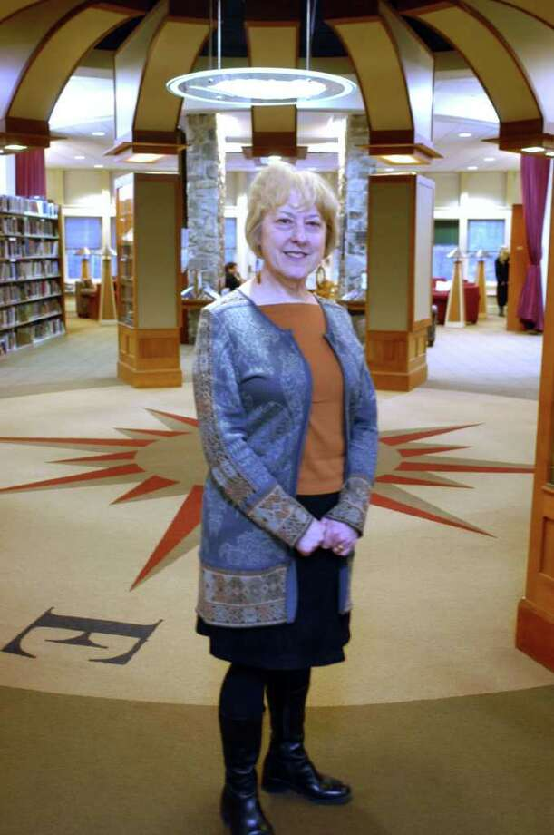 "Heather Morgan, executive director of the Mark Twain Library in Redding, has ""put the library on the Mark Twain map,"" nationally and internationally, according to library Board of Trustees member Robert Morton. She is retiring in June. Photo: John Pirro / The News-Times"